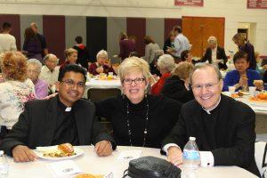2018 St. Luke Award recipient Bobbie Bradley and her pastor Fr. Timothy Bradley (r) and Fr. Piotr (l)